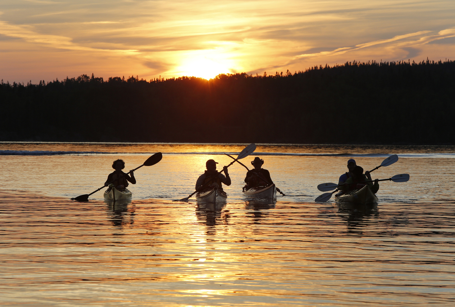 canoeing on lake at sunset